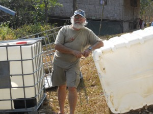 Steve takes a break from cutting the totes into grow beds, a sump and a fish tank.