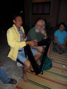 Steve instructs Joe on the harp