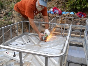 Steve prepares the tray for the grow beds.