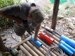 Steve is making the siphon valves for the grow beds.