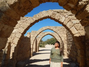 Shirley walking through the ruins of the old city of Caesarea.