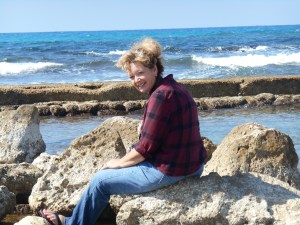 Elaine enjoying the wind and the waves at Caesarea.